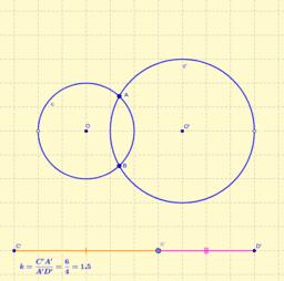 Dividir secante común de dos circunferencias en la razón dada